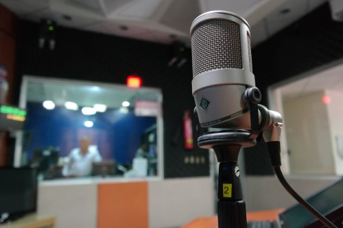 professional voice talents microphone with studio control room background