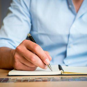 Man taking notes